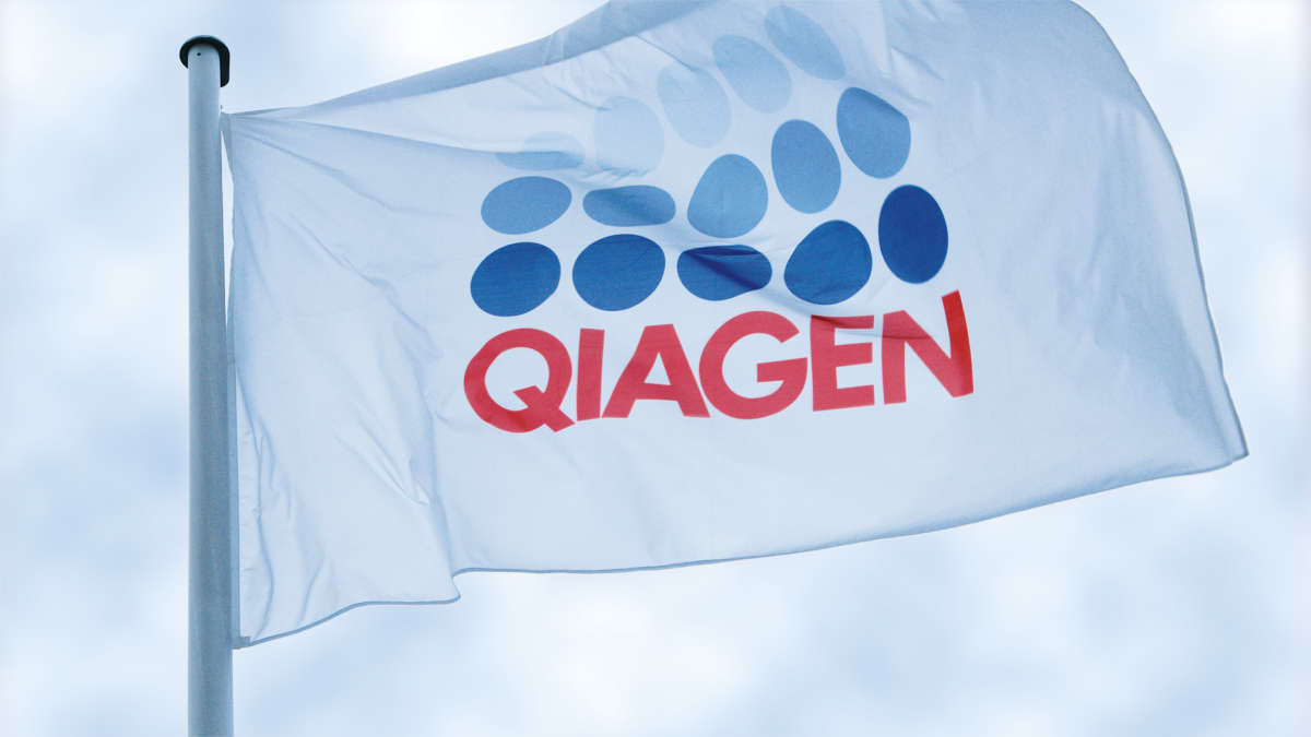 A white flag with QIAGEN logo with the sky in the background